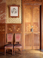 A portrait of Josefa Blasco, wife of Joaquin Navas, the original owner of the house, hangs on the wall of the living room, which is lined with marquetry panelling