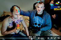 """A still from a video made by members of 'Occupy Pedophilia', a militantly homophobic group that specialises in hunting and filming violent attacks on suspected gays and pedophiles (the group believes that gays and pedophiles are almost equally immoral and that most gays are pedophiles and vice-verse). On the popular online TV-show 'Occupy Pedophilia' victims are tricked into false dates. But instead of a romantic encounter, this band of armed ultra-nationalists are lying in wait. Once caught and confronted the victim is sexually humiliated and tortured, while everything is filmed, posted publicly and shared online. According to the group more than 70 videos have been made so far - with more to come. This video shows an unidentified man who has had 'FAGGOT"""" written on his chest being filmed by a gang of men. The TV station's logo, in the corner, bears the title 'NETTING THE FAGGOTS!'. (MANDATORY CREDIT   photo: Mads Nissen/Panos Pictures /Felix Features)"""