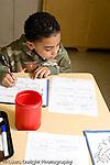 Education Elementary Grade 2 boy writing in science class horizontal