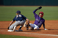 Drake Varnado (13) of IMG Academy in Port Neches, TX playing for the Colorado Rockies scout team slides into third base as pitcher Coleman Willis (38) of Houston County HS in Warner Robins, GA playing for the Milwaukee Brewers scout team waits for the throw during the East Coast Pro Showcase at the Hoover Met Complex on August 5, 2020 in Hoover, AL. (Brian Westerholt/Four Seam Images)