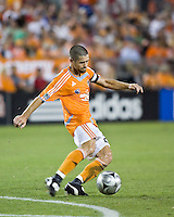 Houston Dynamo defender Wade Barrett (24) strikes the ball.   Houston Dynamo and FC Dallas played to a 1-1 tie at Robertson Stadium in Houston, TX on June 26, 2008.