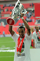 FAO: SPORTS PICTURE DESK-NO BYLINE PLEASE<br /> Pictured: Hat trick scorer for Swansea Scott Sinclair lifts the trophy after his team's win. Monday 30 May 2011<br /> Re: Reading v Swansea npower Championship play-offs final at the Wembley Stadium, London.<br /> NO BYLINE PLEASE