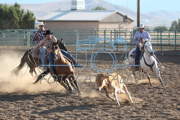 The Centennial team competes in the ranch doctoring event at the Minden Ranch Rodeo on Saturday, July 23, 2011, in Gardnerville, Nev. .Photo by Cathleen Allison