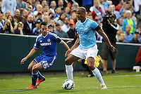 Vincent Kompany (4) Manchester City watched by Cesar Azpilicueta (28) Chelsea..Manchester City defeated Chelsea 4-3 in an international friendly at Busch Stadium, St Louis, Missouri.