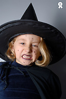 Girl (5-7) dressed up as witch for Halloween, making scary faces (Licence this image exclusively with Getty: http://www.gettyimages.com/detail/73532502 )