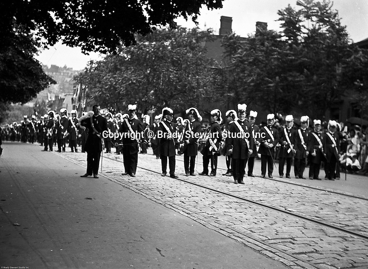 Pittsburgh PA:  Pittsburgh-area Manson marching in the annual St Patrick's Day Parade.  View of Homer Stewart and fellow Masons preparing to march with crowds on both sides of the street.