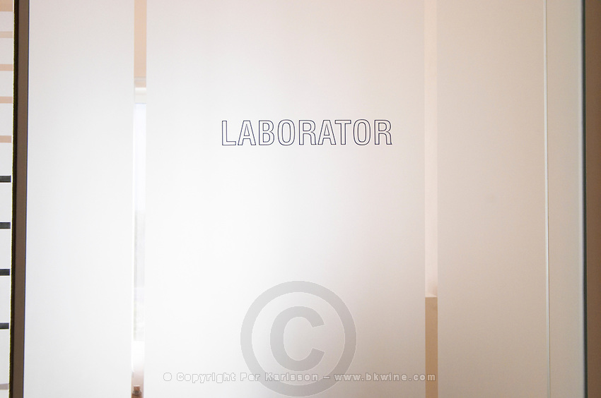 The door to the laboratory department. Frosted glass with text Laborator. Kantina e Pijeve Gjergj Kastrioti Skenderbeu Skanderbeg winery, Durres. Albania, Balkan, Europe.