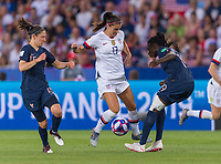 PARIS,  - JUNE 28: Alex Morgan #13 is tackled by Griedge Mbock Bathy #19 during a game between France and USWNT at Parc des Princes on June 28, 2019 in Paris, France.