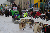2010 Iditarod Ceremonial Start in Anchorage Alaska musher # 18 ROSS ADAM with Iditarider FREEDOM FROG