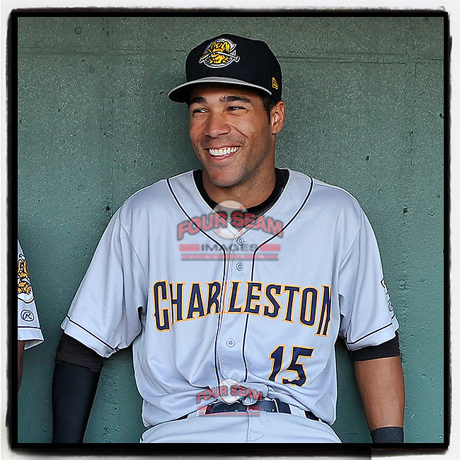 Center fielder Dom Thompson-Williams (15)) of the Charleston RiverDogs waits in the dugout before Game 2 of the South Atlantic League Southern Division Playoff against the Greenville Drive on Friday, September 8, 2017, at Fluor Field at the West End in Greenville, South Carolina. Charleston won, 2-1, and the series is tied at one game each. (Tom Priddy/Four Seam Images)