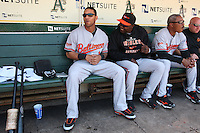 OAKLAND, CA - JUNE 7:  Robert Andino and Felix Pie of the Baltimore Orioles get ready in the dugout before the game against the Oakland Athletics at the Oakland Coliseum in Oakland, California on Sunday, June 7, 2009.  The Athletics defeated the Orioles 3-0.  Photo by Brad Mangin