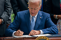 United States President Joe Biden participates in a signing ceremony to restore and protect 3 national monuments on the North Lawn of the White House in Washington, DC, USA, 08 October 2021. President Biden during his remarks highlighted steps the Biden-Harris Administration is taking to better conserve and restore lands and waters that sustain the health of our communities, tackle the climate crisis, and power good jobs and a strong economy.<br /> CAP/MPI/RS<br /> ©RS/MPI/Capital Pictures