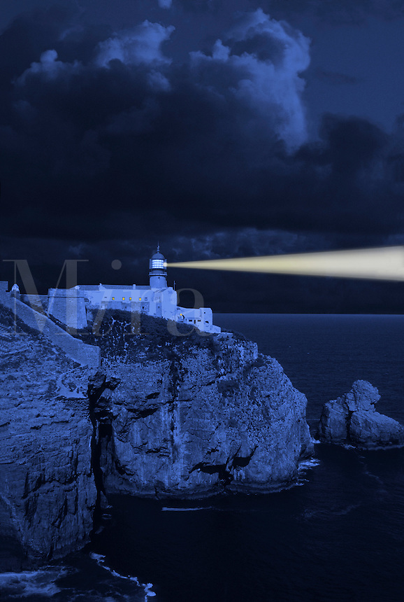 Clifftop lighthouse warning shipping of the dangers of a rocky coast.  Digital manipulation..