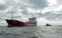 A pilot boat drops off its pilot near Tainio lighthouse while approaching Lovissa in southern Finland.