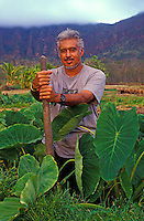 Eric Enos, Director of Kaala Farms, working in the kalo loi (taro pond) at the Hawaiian culture learning center in Waianae