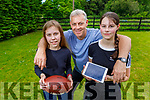 Presentation Castleisland students, Emily and Laura Walsh with their dad Moss, as they try to stay active at home in Cordal on Thursday.