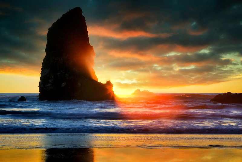 Sunset with some fog at Cannon Beach. Oregon. Sky added
