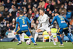 Cristiano Ronaldo(c) of Real Madrid competes for the ball with Hugo Mallo Novegil (l) and Facundo Roncaglia of RC Celta de Vigo during their Copa del Rey 2016-17 Quarter-final match between Real Madrid and Celta de Vigo at the Santiago Bernabéu Stadium on 18 January 2017 in Madrid, Spain. Photo by Diego Gonzalez Souto / Power Sport Images