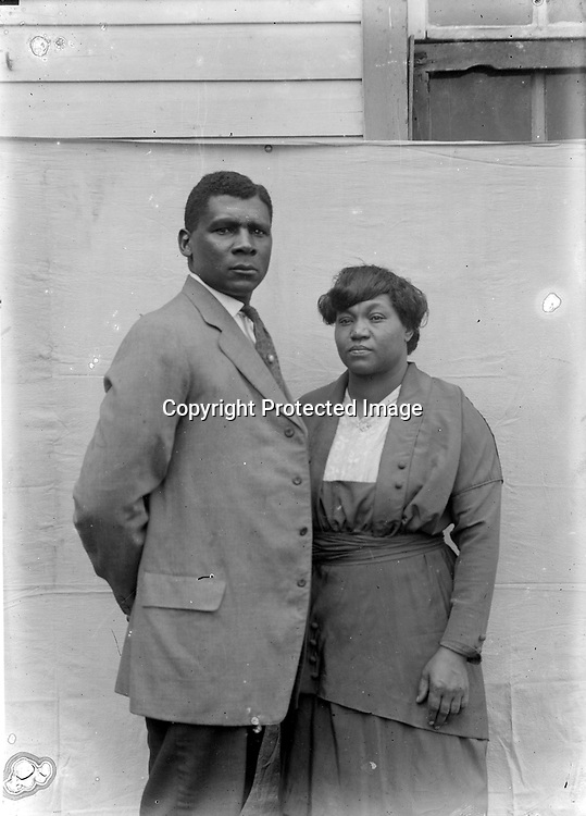MAN AND WOMAN. John Johnson's best portraits seem to allow his subjects to present themselves, rather than imposing the photographer's view of them. Of course, that seeming transparency is a hallmark of a talented photographer.<br /> <br /> Photographs taken on black and white glass negatives by African American photographer(s) John Johnson and Earl McWilliams from 1910 to 1925 in Lincoln, Nebraska. Douglas Keister has 280 5x7 glass negatives taken by these photographers. Larger scans available on request.