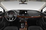 Stock photo of straight dashboard view of 2021 Audi Q5 Premium 5 Door SUV Dashboard