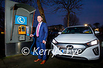 Marcus O'Shea from Adams of Tralee standing at the Eir phone box in Tralee with an electric car on Tuesday.