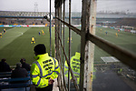 Forfar Athletic 1 Edinburgh City 2, 02/02/2017. Station Park, SPFL League 2. A steward looks on from the main stand at Station Park, Forfar during the SPFL League 2 fixture between Forfar Athletic and Edinburgh City (yellow). It was the club's sixth and final meeting of City's inaugural season since promotion from the Lowland League the previous season. City came from behind to win this match 2-1, watched by a crowd of 446. Photo by Colin McPherson.