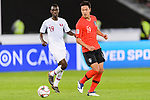 Kim Younggwon of South Korea (R) fights for the ball with Almoez Ali of Qatar (L) during the AFC Asian Cup UAE 2019 Quarter Finals match between Qatar (QAT) and South Korea (KOR) at Zayed Sports City Stadium  on 25 January 2019 in Abu Dhabi, United Arab Emirates. Photo by Marcio Rodrigo Machado / Power Sport Images
