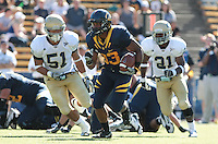 Covaugh DeBoskie-Johnson carries the ball. The University of California Berkeley Golden Bears defeated the UC Davis Aggies 52-3 in their home opener at Memorial Stadium in Berkeley, California on September 4th, 2010.