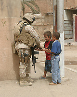 south central Ramadi, Iraq, Sept. 6, 2007. - <br /> U.S. Marine Corps Sgt. Maj. William Jordan, with 2nd Battalion, 5th Marine Regiment, 3rd Infantry Division, II Marine Expeditionary Force, interacts with local children during a patrol through south central Ramadi, Iraq, Sept. 6, 2007. The Marines conducted atmospherics with local civilians and police officers during the patrol. (U.S. Marine Corps photo by Staff Sgt. Michael Kropiewnicki) (Released)