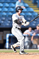 Charleston RiverDogs shortstop Kyle Holder (4) swings at a pitch during game one of a double header against the Asheville Tourists at McCormick Field on July 8, 2016 in Asheville, North Carolina. The RiverDogs defeated the Tourists 10-4 in game one. (Tony Farlow/Four Seam Images)