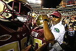 Florida State Seminoles head coach Willie Taggart hugs wide receiver Keyshawn Helton as they celebrate after an NCAA college football game against North Carolina State in Tallahassee, Fla., Saturday, Sept. 28, 2019. Florida State defeated North Carolina State 31-13.   (AP Photo/Mark Wallheiser)