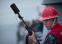 130423-N-DR144-053 Pacific Ocean (April 23, 2013)- Gunner's Mate Seaman Montgomery Cox prepares to fire shot lines from the Amphibious Transport Dock Ship USS Anchorage (LPD 23) as the ship approaches to take on fuel from fleet replenishment oiler USNS Henry J. Kaiser (T-AO 187). Anchorage is currently en route to its namesake city of Anchorage, Alaska for its commissioning ceremony May 4. (U.S. Navy photo by Mass Communication Specialist 1st Class James R. Evans / RELEASED)