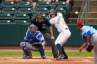 Montgomery Biscuits designated hitter Daniel Robertson (4) at bat in front of catcher Kyle Schwarber and umpire Alex Ransom during a game against the Tennessee Smokies on May 25, 2015 at Riverwalk Stadium in Montgomery, Alabama.  Tennessee defeated Montgomery 6-3 as the game was called after eight innings due to rain.  (Mike Janes/Four Seam Images)