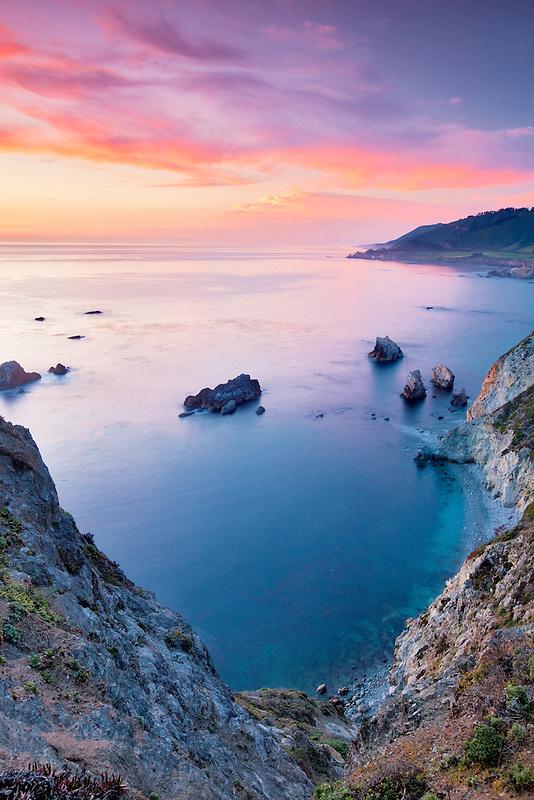 Sunset with offshore rocks. Big Sur coast. California