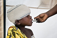 A child is treated inside the Medecins Sans Frontieres (MSF) mobile clinic in the Kibati camp for displaced people. Thousands of people have been forced to leave their homes after renewed fighting in the region.
