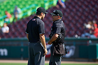Umpires Alex Nash and Randy Wilmes discuss a call during a California League game against the Inland Empire 66ers on April 14, 2019 at The Diamond in Lake Elsinore, California. Lake Elsinore defeated Inland Empire 5-3. (Zachary Lucy/Four Seam Images)