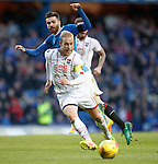 Andrew Davies steers the ball away from Jon Toral