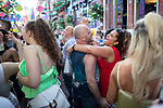 © Joel Goodman - 07973 332324 - all rights reserved . 25/08/2019. Manchester, UK. People dance on Canal Street . Revellers in Manchester's Gay Village during the city's annual Gay Pride festival , which celebrates LGBTQ+ life and is the largest of its type in Europe . Photo credit : Joel Goodman