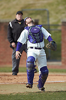 High Point Panthers catcher Justin Wilkins (45) tracks a pop fly during the game against the Bryant Bulldogs at Williard Stadium on February 21, 2021 in  Winston-Salem, North Carolina. The Panthers defeated the Bulldogs 3-2. (Brian Westerholt/Four Seam Images)