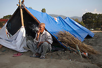 Elder man living in a temporary shelter as their houses were damaged at Bhaktapur, near Kathmandu, Nepal. May 03, 2015
