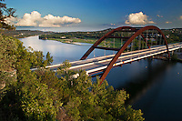 A late afternoon, Austin, Texas view of the Pennybacker Bridge or '360 Bridge' as it is more commonly known. The bridge spans across Lake Austin and connects the Capitol of Texas Highway (Loop 360). You can see downtown Austin off to the left on the horizon.