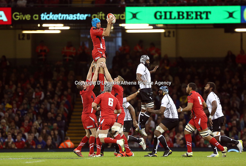 Pictured: Justin Tipuric of Wales (C) catches the ball from a line out. Saturday 15 November 2014<br /> Re: Dove Men Series rugby, Wales v Fiji at the Millennium Stadium, Cardiff, south Wales, UK.