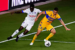 Jesus Duenas of Tigres UANL (MEX) fights for the ball against Marvin Bernardez of CD Olimpia (HON) during their CONCACAF Champions League Semi Finals match at the Orlando's Exploria Stadium on 19 December 2020, in Florida, USA. Photo by Victor Fraile / Power Sport Images