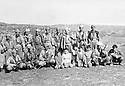 Iraq 1985 <br /> In a village near Zakho, Najmeddin Yousefi, 3rd right,and peshmergas posing for the picture with children of the village  <br /> Irak 1985 <br /> Dans un village pres de Zakho, Najmeddin Yousefi , 3eme a droite, et des peshmergas posent pour une photo avec des enfants du village