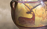 Close up of a Phrygian terra cotta large jug with handles, decorated with animals, from Gordion. Phrygian Collection, 6th century BC - Museum of Anatolian Civilisations Ankara. Turkey. Against an art background