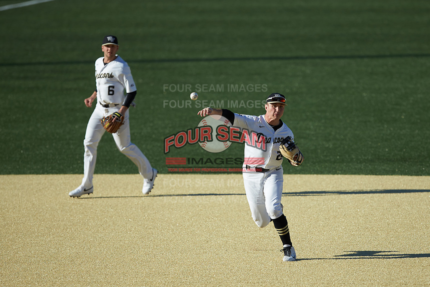 Wake Forest Demon Deacons third baseman Chris Lanzilli (24) makes a throw to first base against the Louisville Cardinals at David F. Couch Ballpark on March 7, 2020 in  Winston-Salem, North Carolina. The Demon Deacons defeated the Cardinals 3-2. (Brian Westerholt/Four Seam Images)