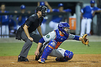 Kingsport Mets catcher Robby Kidwell (25) sets a target as home plate umpire Adam Clark looks on during the game against the Burlington Royals at Burlington Athletic Stadium on July 27, 2018 in Burlington, North Carolina. The Mets defeated the Royals 8-0.  (Brian Westerholt/Four Seam Images)