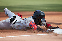 Miguel Aparicio (8) of the Hickory Crawdads slides head first into third base after hitting a triple against the Winston-Salem Dash at Truist Stadium on July 10, 2021 in Winston-Salem, North Carolina. (Brian Westerholt/Four Seam Images)