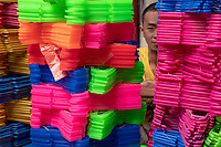A vendor selling colorful Plastic coat hangers in China Town, Manila Philippines.
