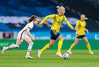SOLNA, SWEDEN - APRIL 10: Caroline Seger #17 of Sweden dribbles during a game between Sweden and USWNT at Friends Arena on April 10, 2021 in Solna, Sweden.